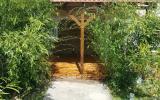 Création d'une terrasse en bois exotique sur chape existante avec brise vue